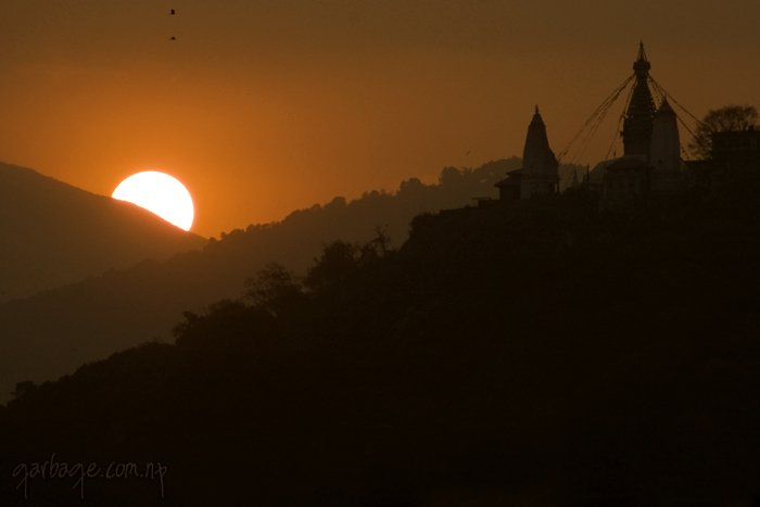 A view of sunset with silhouette of Shwayambhu, taken from the hills of Maharajgunj, Kathmandu.