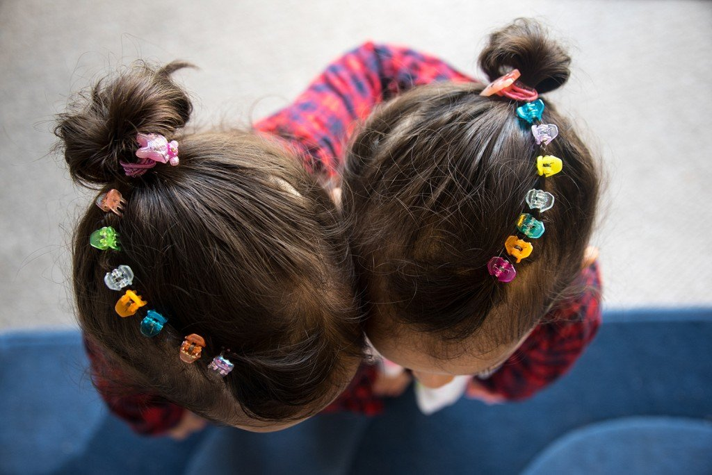 Colorful clips in Ellen & Erin's hair.
